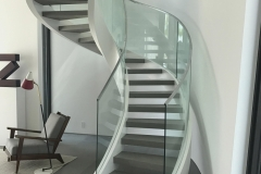 metal-and-glass-unique-design-curved-staircase-railing-akouri-metal-miami-florida